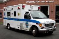 Side view of ambulance in front of Fire House