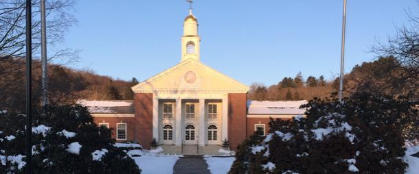 Photo of front of Town hall building with snow on ground in front